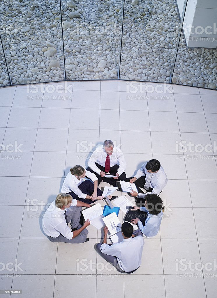 Aerial view of a group of office workers meeting in a rotunda royalty-free stock photo