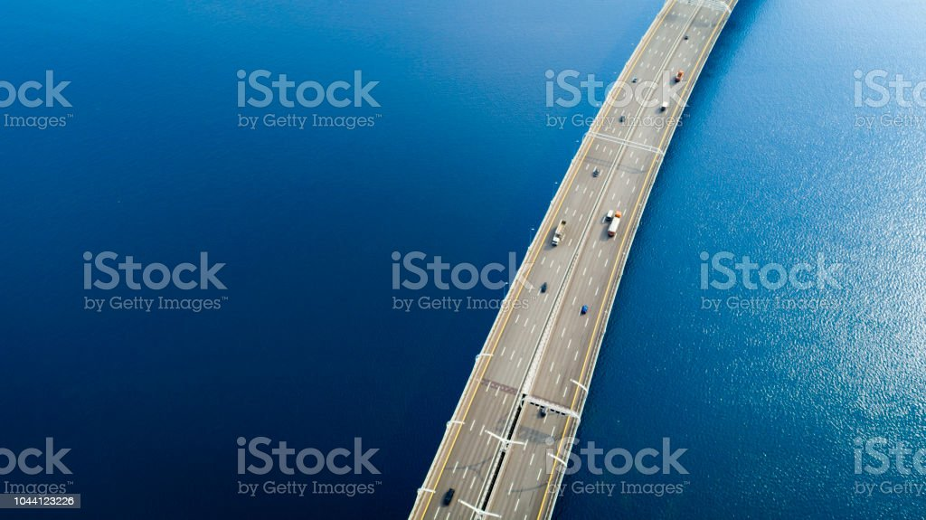 Aerial view of a high way over blue water stock photo