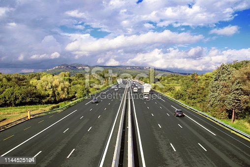 A highway is a divided lane reserved for the rapid movement of motorized vehicles. It does not include any level crossing and is accessible by points designed for this purpose.
