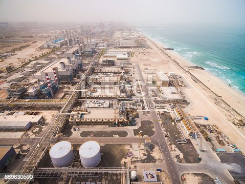 istock Aerial view of a huge power plant on the shore of the sea in Dubai, UAE 689630590