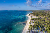 Aerial view of the coastline of Nemberala village on the island of Rote in Timor province of Indonesia, with a white sand beach facing a blue lagoon. Rote is becoming a well known destination for surf.