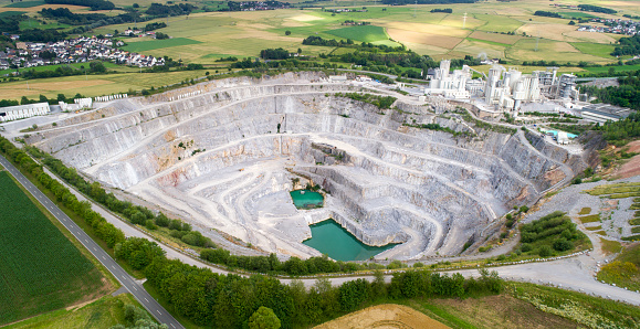 Aerial view of a large limestone quarry and industrial buildings