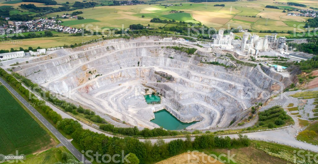 Aerial view of a large limestone quarry and industrial buildings stock photo