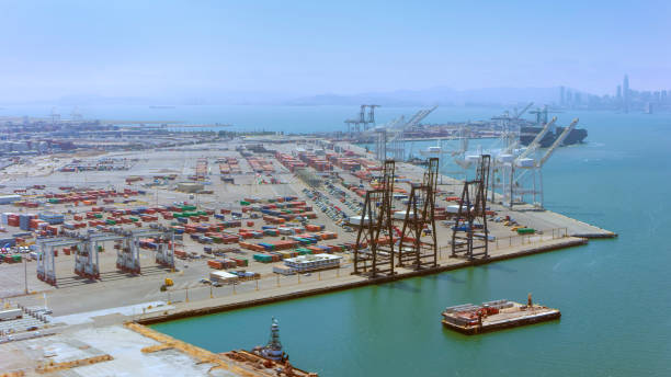 Aerial view of a large ship loading dock in California, USA Aerial view of a large container ship dock in California, USA. mooring stock pictures, royalty-free photos & images