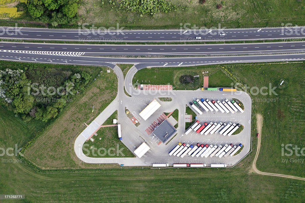 Aerial view of a lorry park beside a main road stock photo