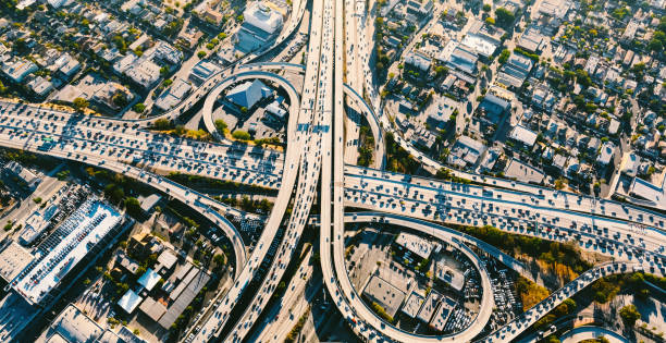 Aerial view of a massive highway intersection in LA Aerial view of a massive highway intersection in Los AngelesAerial view of a massive highway intersection in Los Angeles urban sprawl stock pictures, royalty-free photos & images