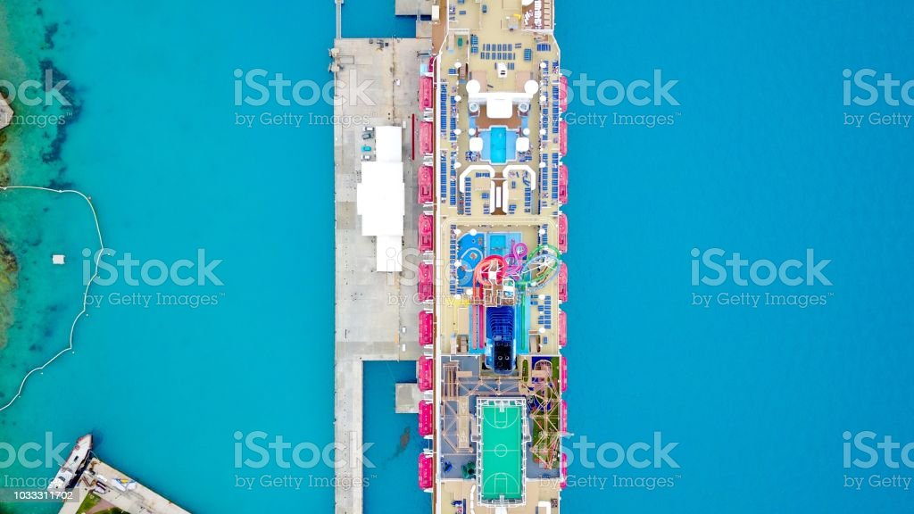 Aerial view of a mega cruise ship in a tropical port stock photo