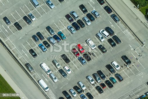 istock Aerial view of a parking lot with many cars in rows in Munich, Germany 963424638