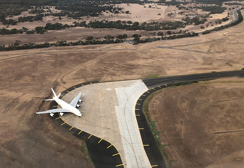 istock Aerial view of a passenger jet 1148399078