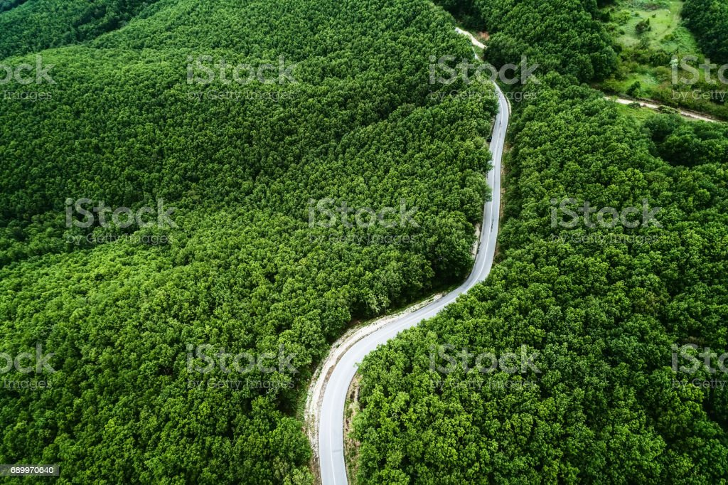 Aerial view of a provincial road passing through a forest stock photo