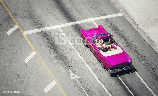 Havana. Cuba - july 31, 2018: top view taxi vintage cars in Old Havana streets with tourist, Cuba