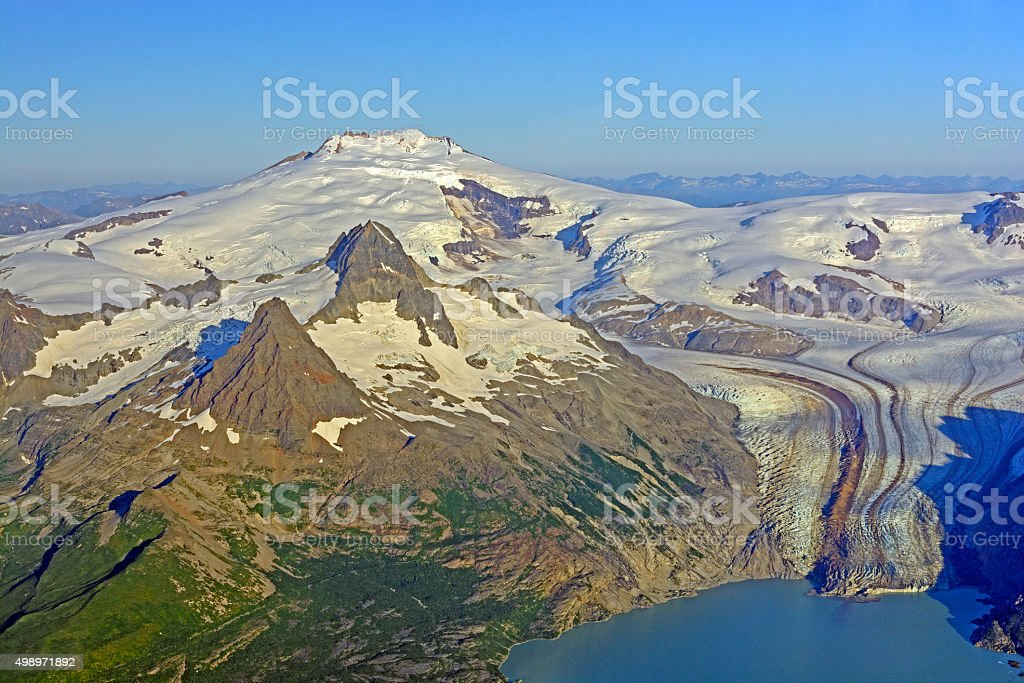 Aerial View of a Remote Volcano and Glacier in Alaska stock photo