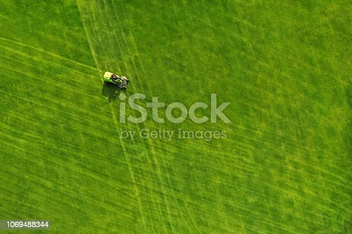 Directly above view of lawn mower on grass field