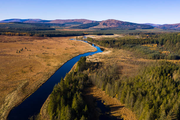 Aerial view of a river running through a remote area of south west Scotland stock photo