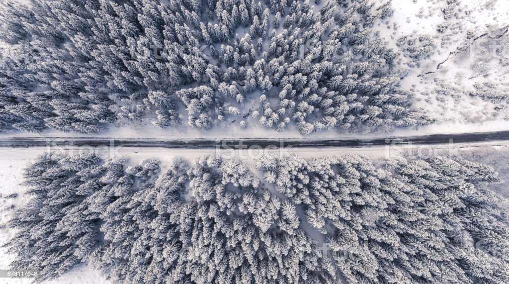 Aerial view of a road in winterland stock photo