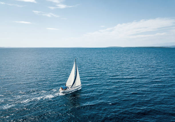 aerial view of a sailing boat - sail stock pictures, royalty-free photos & images