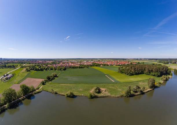 Aerial view of a small lake in the district of Buechenbach of the city of Erlangen Aerial view of a small lake in the district of Buechenbach of the city of Erlangen, Bavaria - Germany erlangen stock pictures, royalty-free photos & images