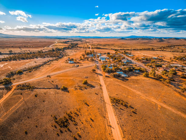 Aerial view of a small town in vast plains of South Australian outback Aerial view of a small town in vast plains of South Australian outback outback stock pictures, royalty-free photos & images