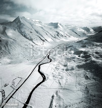 aerial view of a snowed road in westfjord - iceland