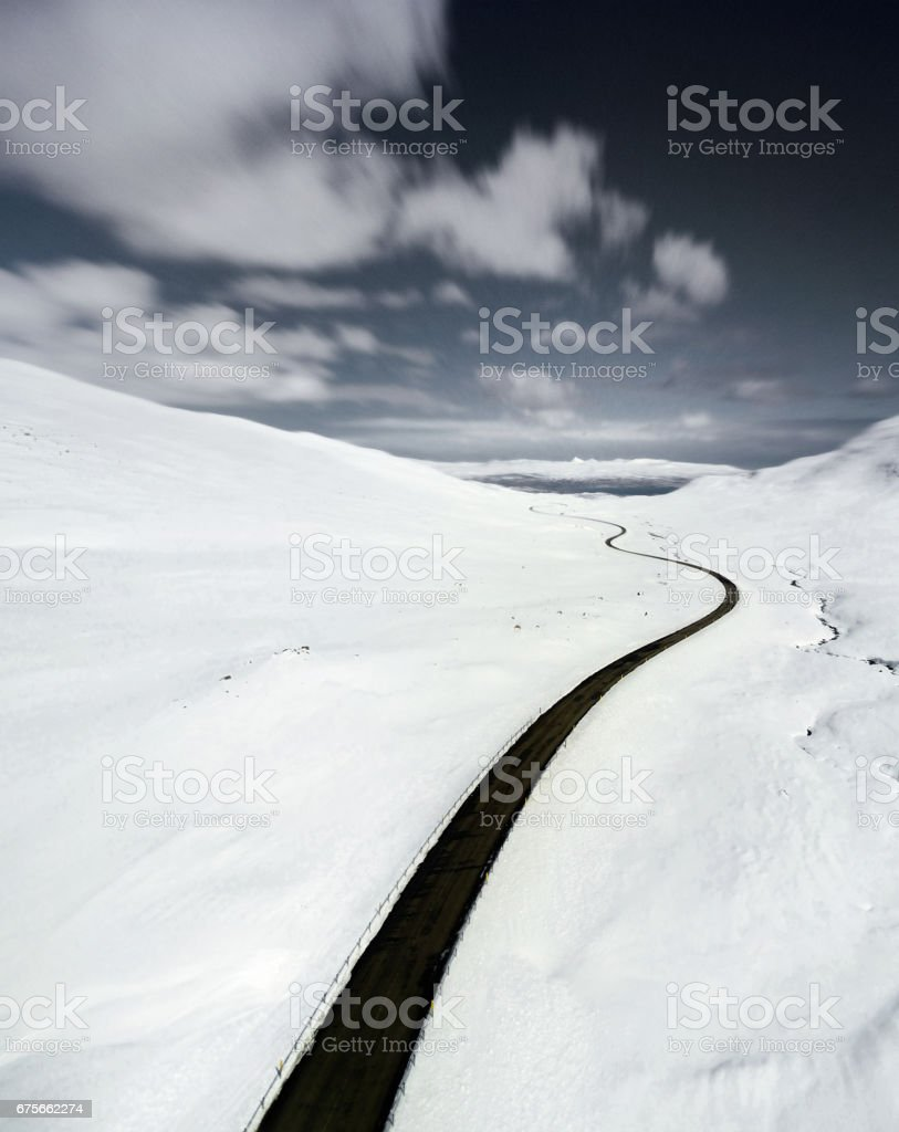 aerial view of a snowed road in westfjord - iceland royalty-free stock photo