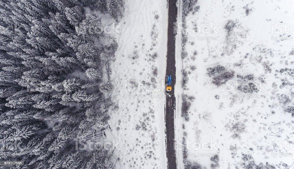 Aerial view of a snowplow truck on a snowy day stock photo