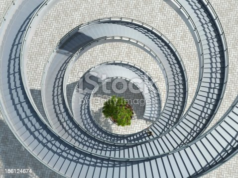 istock Aerial view of a spiral staircase with a tree in the middle 186124674