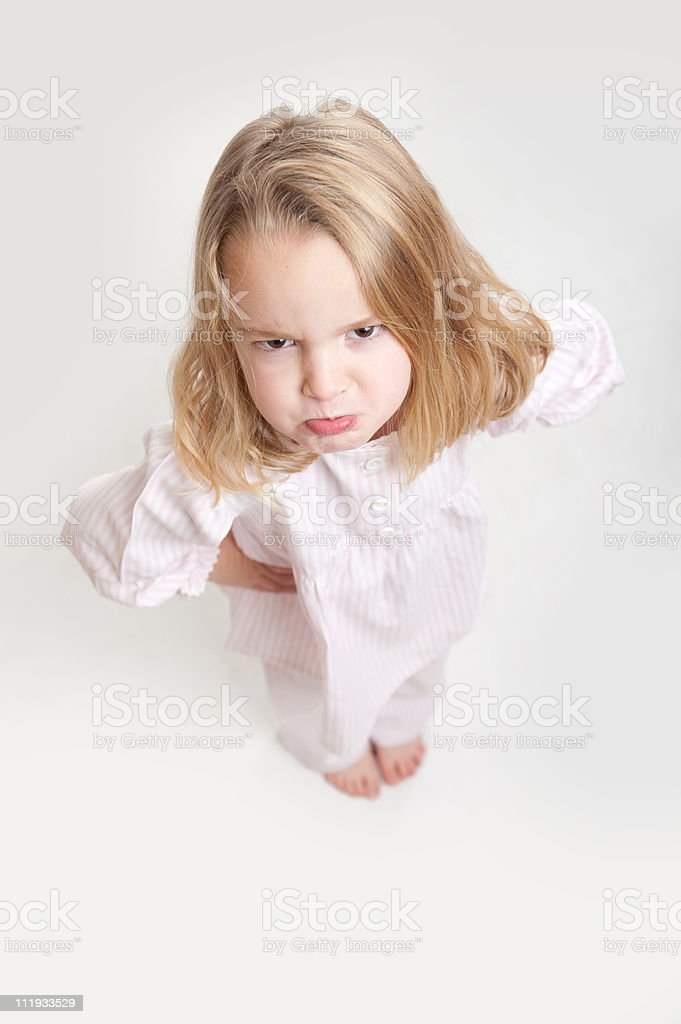 Aerial view of a sulking blonde kid in her pajamas royalty-free stock photo