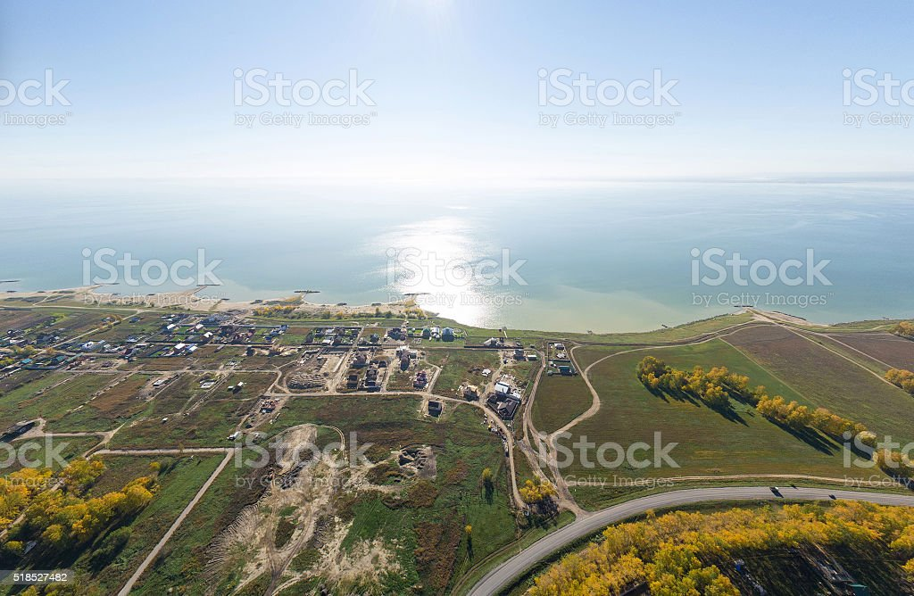 Aerial view of a summer house village at blue sea stock photo