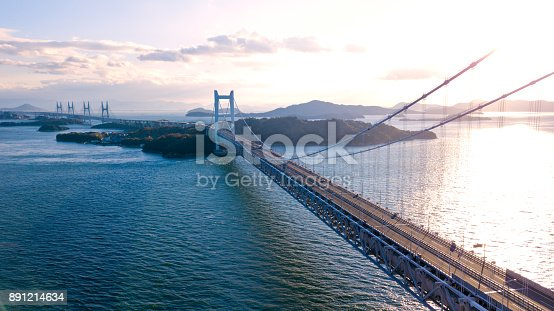 istock Aerial view of a sunset over the Great Seto bridge, Japan 891214634