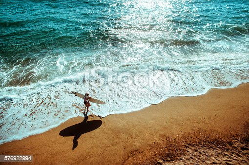 istock Aerial view of a surfer girl 576922994