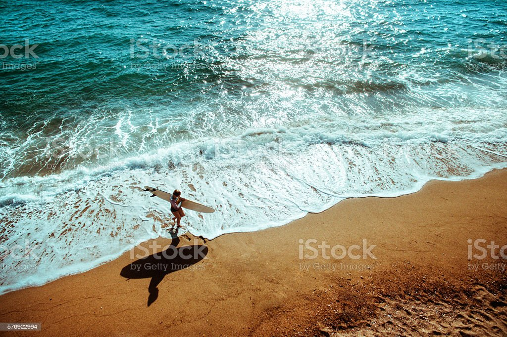 Aerial view of a surfer girl stock photo