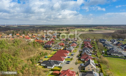 1095367134 istock photo Aerial view of a typical German residential area, taken with the drone 1146265445