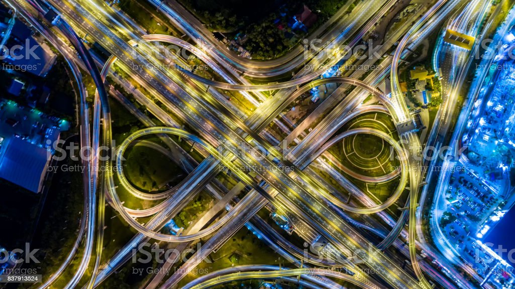 Aerial view of a Unique City Roads and Interchanges, Bangkok Expressway top view, Top view over the highway, expressway and motorway at night Aerial view from drone stock photo