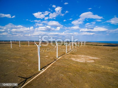 892160114 istock photo Aerial view of a wind turbine 1049201750