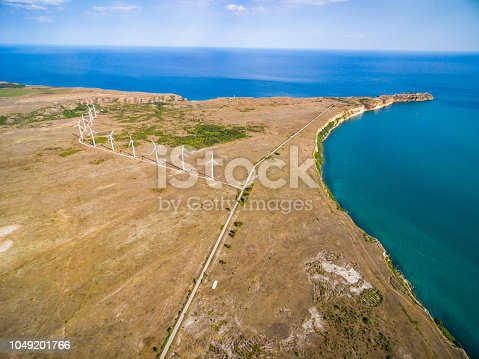 892160114 istock photo Aerial view of a wind turbine 1049201766