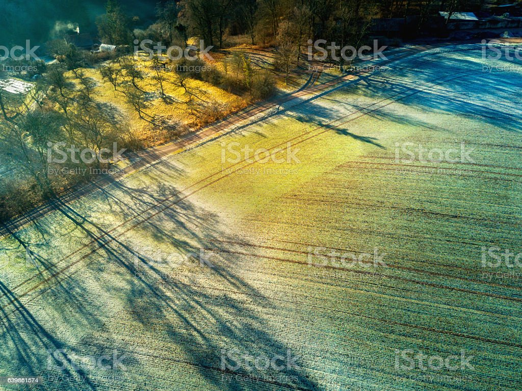 Aerial view of a winter landscape with field stock photo
