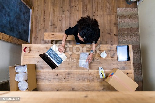 istock Aerial view of a woman wrapping products 629303716