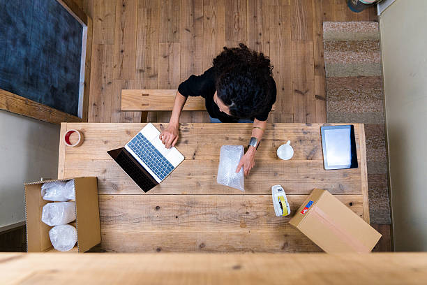 Aerial view of a woman wrapping products stock photo