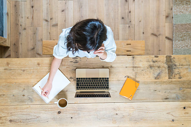 Aerial view of a young woman studying at home stock photo
