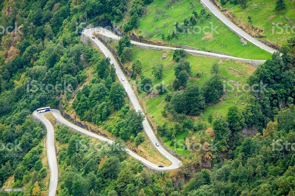 aerial view of a zig-zag winding road stock photo