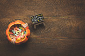 Aerial view of accessory decoration Happy Halloween festival background concept.Mix object on modern rustic brown wooden at home office desk.trick or treat