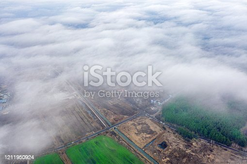 istock Aerial view of agrarian fields from aerial view. 1211950924