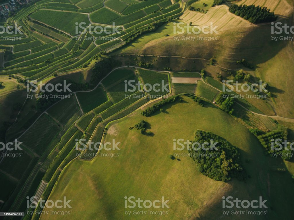 aerial view of agricultural fields and green hills, europe - Zbiór zdjęć royalty-free (Dzień)