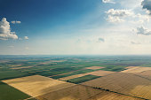 Aerial view of agricultural fields. Cloudy countryside, Aerial view.