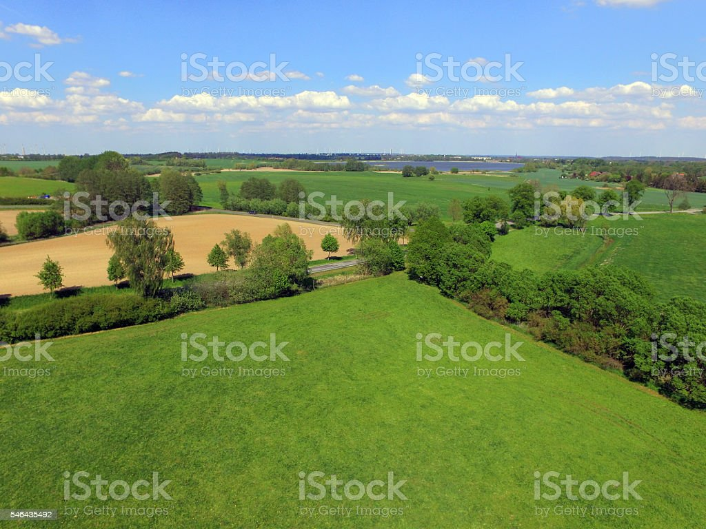 Aerial View  of Agricultural Fields with blue sky in germany stock photo