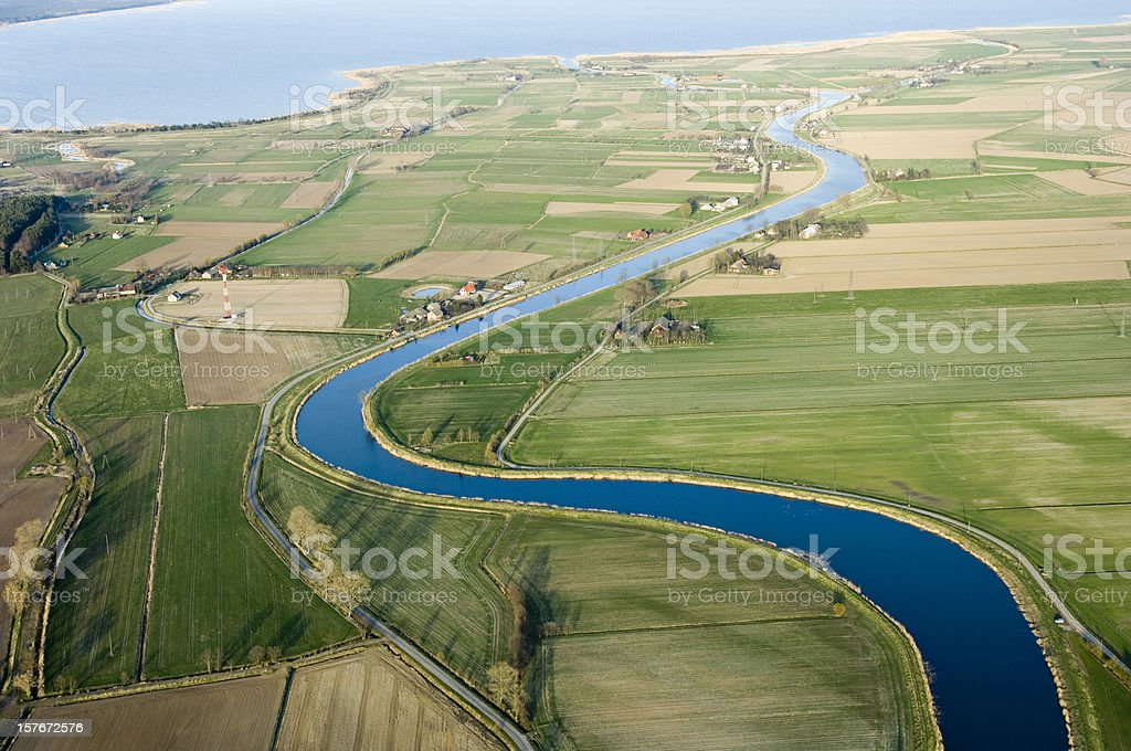 Aerial view of agricultural land and a river royalty-free stock photo