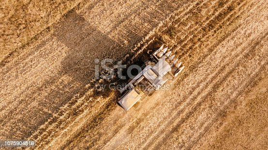 1072634078 istock photo Aerial view of agriculture industry - harvesting 1075904816