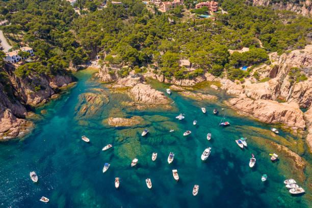aerial view of aigua xelida beach bay with boats in Begur, Costa brava, Spain stock photo