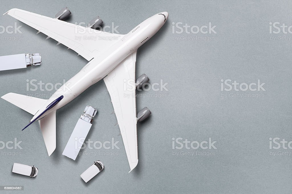 Aerial View Of Airplane And Trucks stock photo