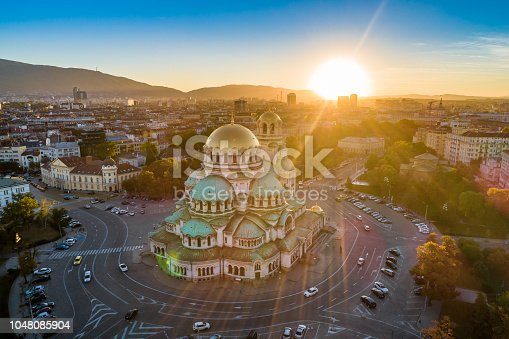 Aerial view of Alexander Nevski cathedral in Sofia, Bulgaria with setting sun. The scene is situated in downtown district of Sofia, Bulgaria (Eastern Europe) during sunset. The picture is taken with DJI Phantom 4 Pro drone.